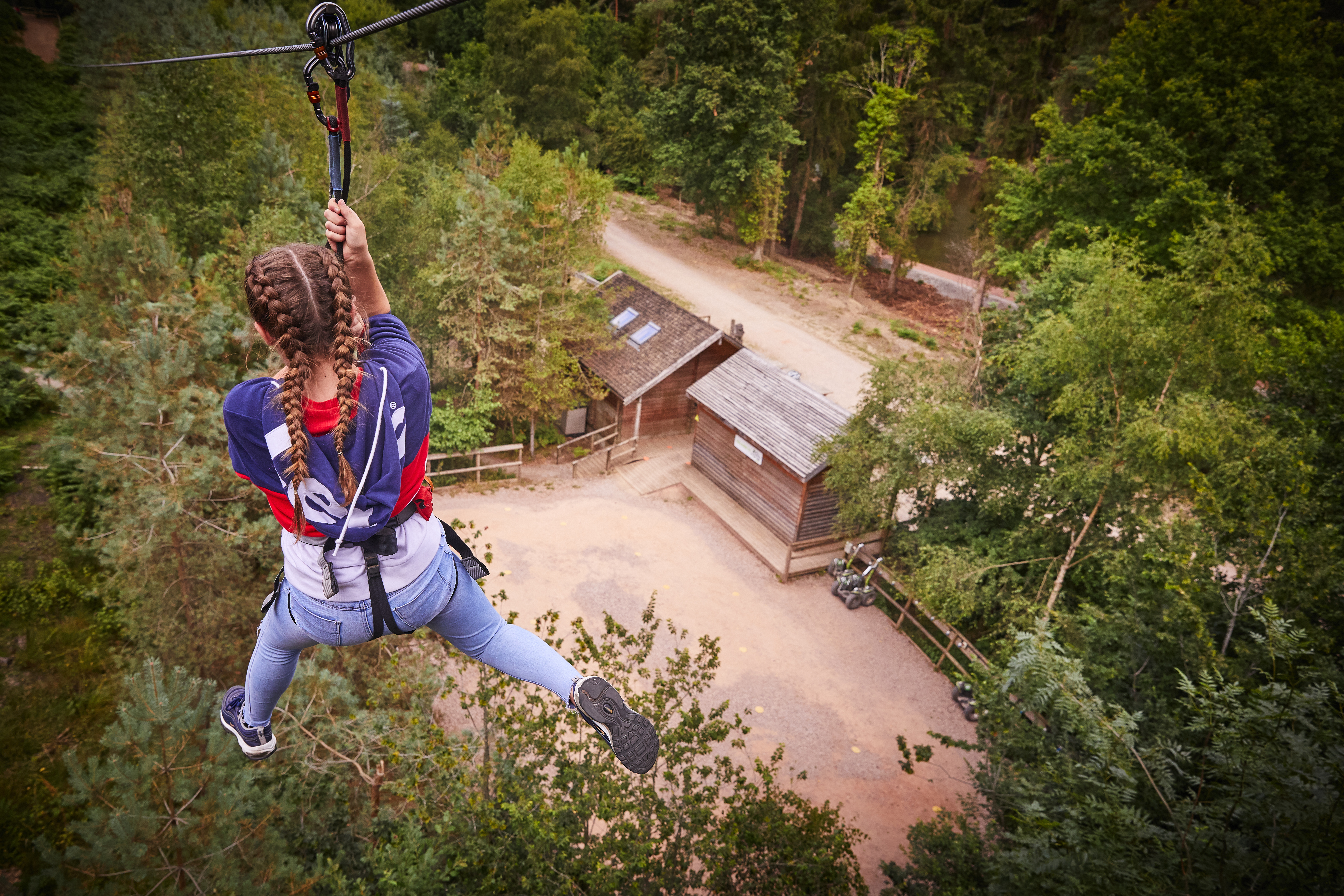 Woman in jeans on a zip wire