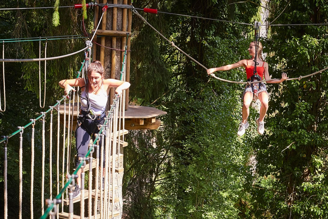Two women on a Go Ape treetop course