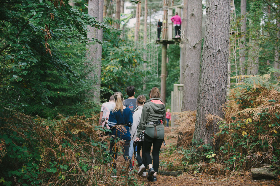 A group of Go Ape customers walking through the forest towards the course
