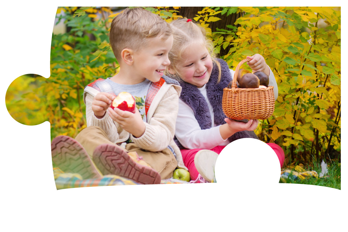 Two children eating a picnic