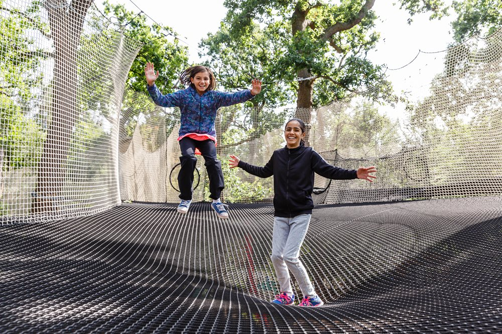 Two girls bouncing on Go Ape Nets Adventure